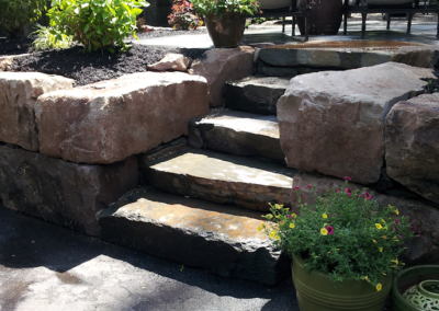 rock work infront of house and steps
